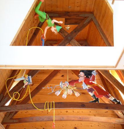 captain hook and peter pan in rafters of train station 2